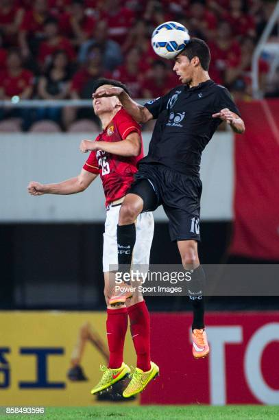 Guangzhou Evergrande midfielder Zou Zheng fights for the ball with Seongnam FC midfielder Jorge De Moura Xavier during the AFC Champions League 2015...
