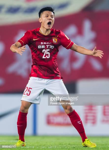 Guangzhou Evergrande midfielder Zou Zheng gestures during the AFC Champions League 2015 Semi Final 1st Leg match between Guangzhou Evergrande and...