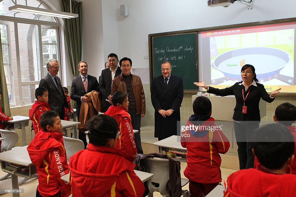 Guangzhou Evergrande owner Xu Jiayin and Real Madrid president <a gi-track='captionPersonalityLinkClicked' href=/galleries/search?phrase=Florentino+Perez&family=editorial&specificpeople=567584 ng-click='$event.stopPropagation()'>Florentino Perez</a> visit Evergrande-Real Madrid Football School on December 27, 2012 in Qingyuan, China. <a gi-track='captionPersonalityLinkClicked' href=/galleries/search?phrase=Florentino+Perez&family=editorial&specificpeople=567584 ng-click='$event.stopPropagation()'>Florentino Perez</a> and his delegation are on a multi-day visit to Guangzhou Evergrande FC, who has a cooperation agreement with Real Madrid that has led to the creation of a football school in Qingyuan.