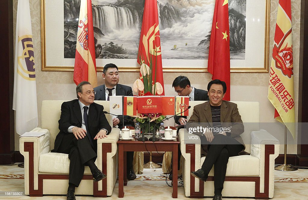 Guangzhou Evergrande owner Xu Jiayin (R) meets with Real Madrid president <a gi-track='captionPersonalityLinkClicked' href=/galleries/search?phrase=Florentino+Perez&family=editorial&specificpeople=567584 ng-click='$event.stopPropagation()'>Florentino Perez</a> at Hengda Hotel on December 26, 2012 in Guangzhou, China. <a gi-track='captionPersonalityLinkClicked' href=/galleries/search?phrase=Florentino+Perez&family=editorial&specificpeople=567584 ng-click='$event.stopPropagation()'>Florentino Perez</a> and his delegation are on a multi-day visit to Guangzhou Evergrande FC, who has a cooperation agreement with Real Madrid that has led to the creation of a football school in Qingyuan.