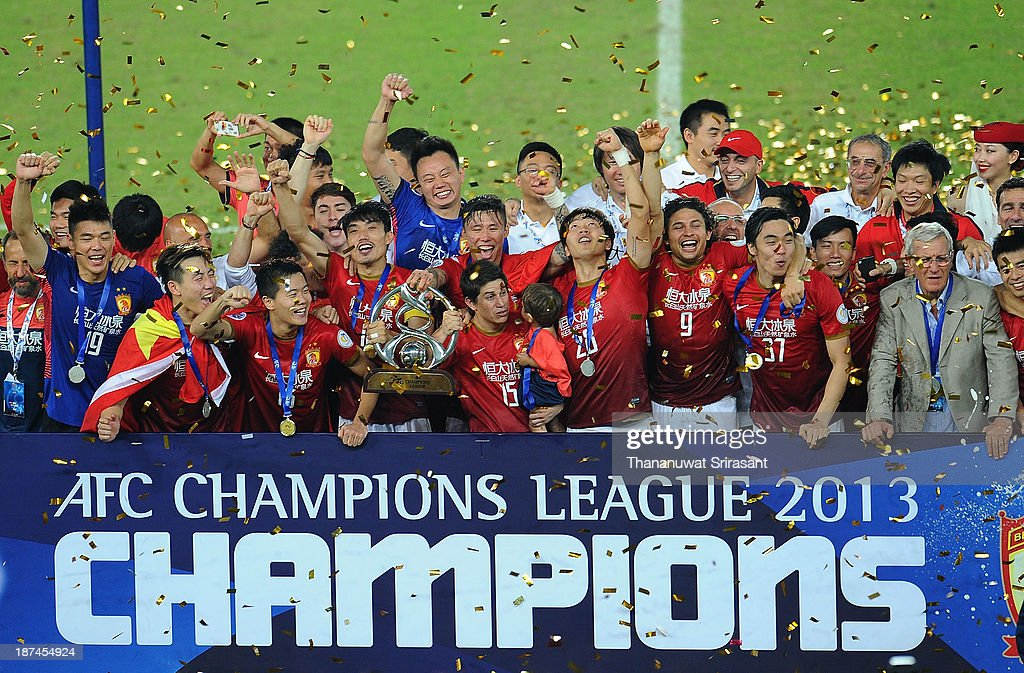 Guangzhou Evergrande players celebrate with the AFC Champions League Final Tropy after winning the 2013 AFC Champions League final at Guangzhou Tianhe Sport Center Stadium on November 9, 2013 in Guangzhou, China.
