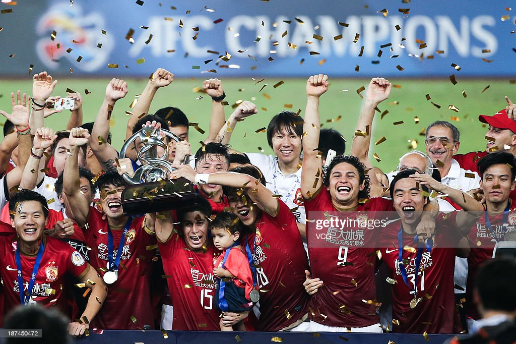 Guangzhou Evergrande players celebrate with the trophy after winning the AFC Champions League Final 2nd leg match against FC Seoul at Tianhe Sports Center on November 9, 2013 in Guangzhou, China.