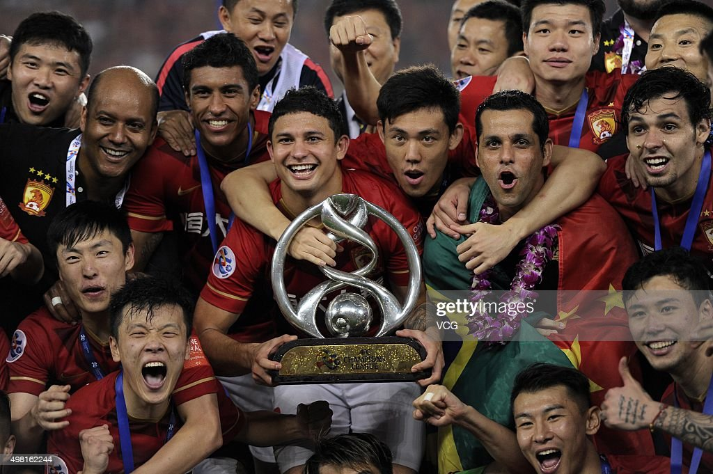 Guangzhou Evergrande players celebrate with the trophy after winning the second leg of the AFC Champions League final match between Guangzhou Evergrande and Al Ahli at the Tianhe Sports Center on November 21, 2015 in Guangzhou, China.