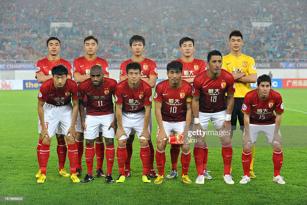 Guangzhou Evergrande players line up prior to the AFC Champions League match between Guangzhou Evergrande and Jeonbuk Hyundai Motors at Tianhe Sports Center on May 1, 2013 in Guangzhou, China.