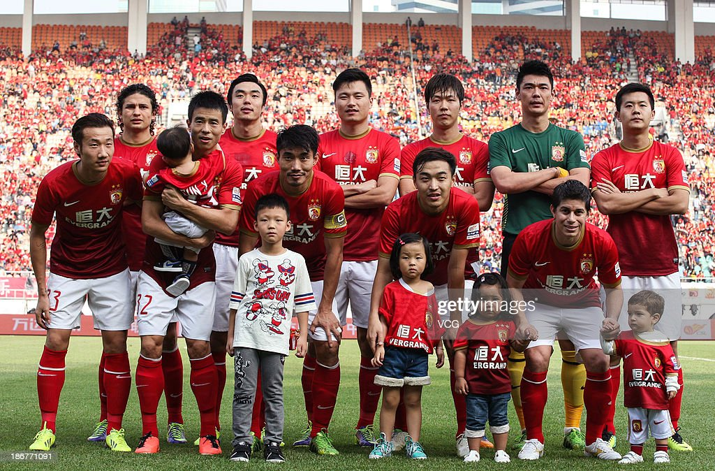 Guangzhou Evergrande players line up prior to the Chinese Super League match between Guangzhou Evergrande and Wuhan Zall at Tianhe Sports Center on November 3, 2013 in Guangzhou, China.