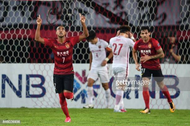 Guangzhou Evergrande's Alan Douglas celebrates after scoring a goal during their AFC Champions League quarterfinal football match against Shanghai...