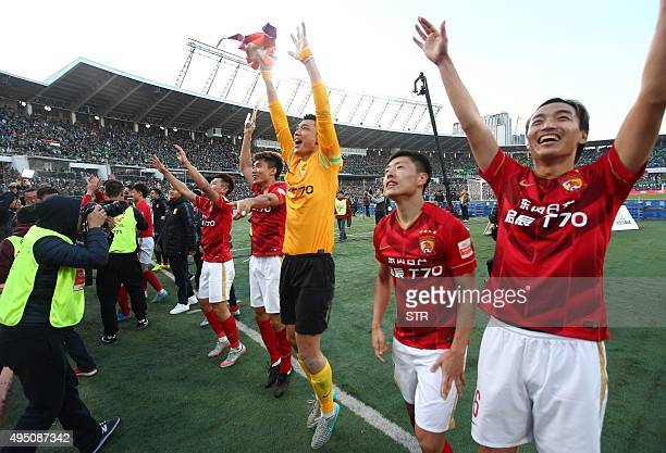 Guangzhou Evergrande's players celebrate after clinching the Chinese football championship in Beijing on October 31 2015 Phil Scolari's Evergrande...