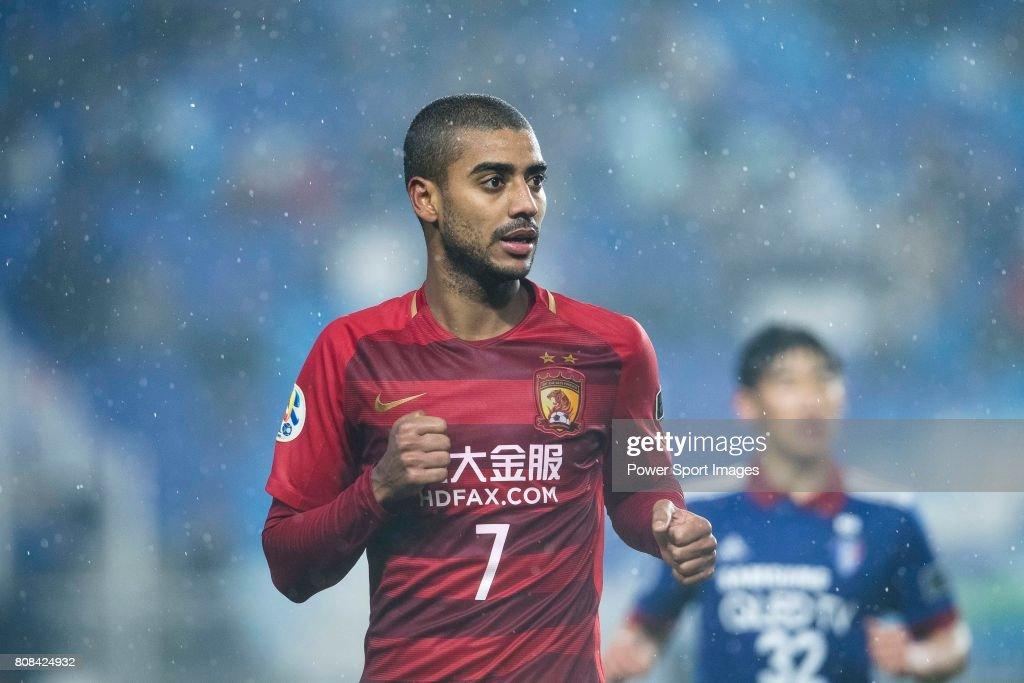 guangzhou forward alan douglas de carvalho celebrating his score during the afc champions league group