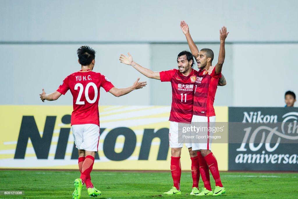 guangzhou forward alan douglas de carvalho celebrating his score with guangzhou forward ricardo goulart during the