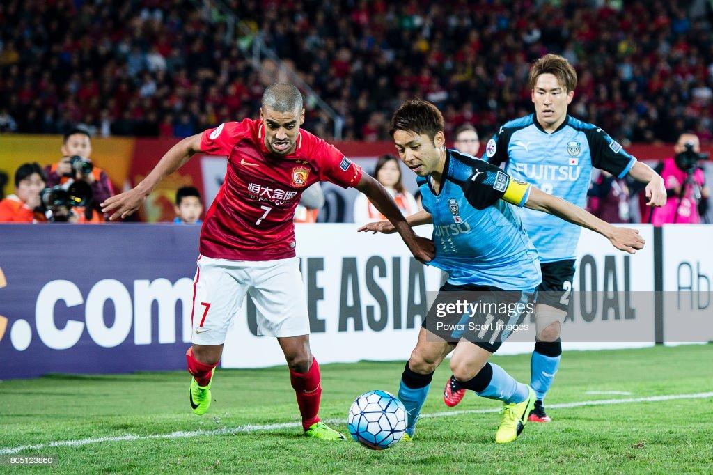 guangzhou forward alan douglas de carvalho l fights for the ball with kawasaki forward
