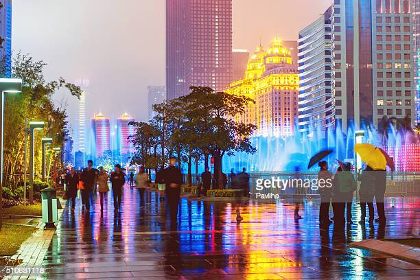 Guangzhou Office Buildings,people abstract,,umbrellas,fountain,night, China