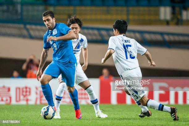 Guangzhou RF forward HamedAllah Abderrazzaq fights for the ball with Gamba Osaka defender Konno Yasuyuki during the 2015 AFC Champions League Group...