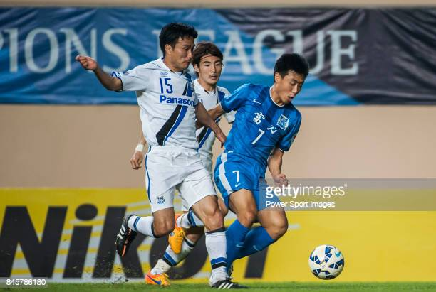 Guangzhou RF midfielder Jiang Ning fights for the ball with Gamba Osaka defender Konno Yasuyuki during the 2015 AFC Champions League Group Stage F...