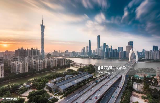Guangzhou TV Tower and Liede Bridge over Pearl River at sunset, Guangzhou, Guangdong, China