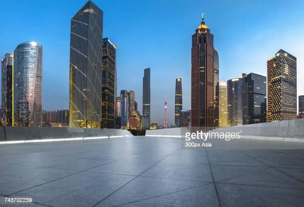 Guangzhou TV Tower and other illuminated modern skyscrapers at night, Guangzhou, Guangdong, China