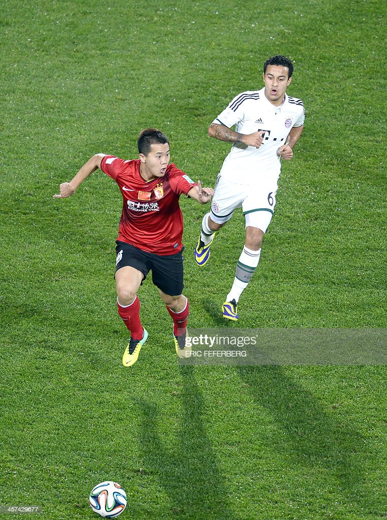 Guangzhou's mildfielder Bowen Huang (L) passes Bayern Munich's Spanish midfielder Thiago Alcantara during their FIFA Club World Cup football semi-final match, in the coastal Moroccan city of Agadir on December 17, 2013. The regional champions from each of the FIFA regions are gathering in the north African country of Morocco to decide which is the best domestic team in the world. Bayern Munich won 3-0.