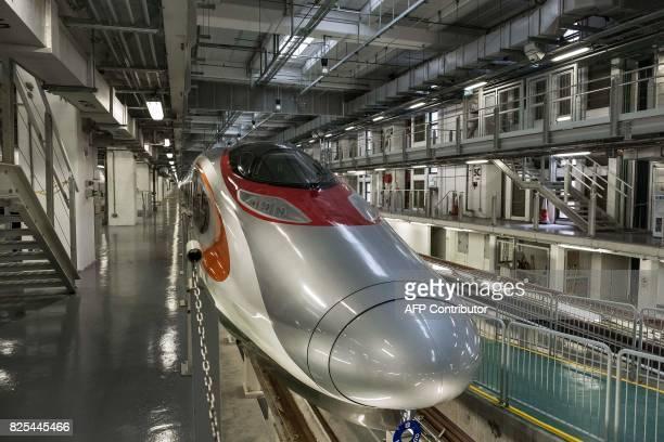 A GuangzhouShenzhenHong Kong Express Rail Link train is seen in Hong Kong on August 2 2017 / AFP PHOTO / POOL / Billy HC Kwok