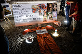 A Guantanamo prisoner uniform and a portrait of USbased cleric Fethullah Gulen Fethullah Gulen are seen on the ground during a rally of proErdogan...
