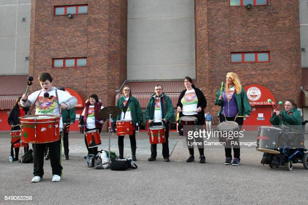 Guarana drummers perform outside Pittodrie Stadium before the match