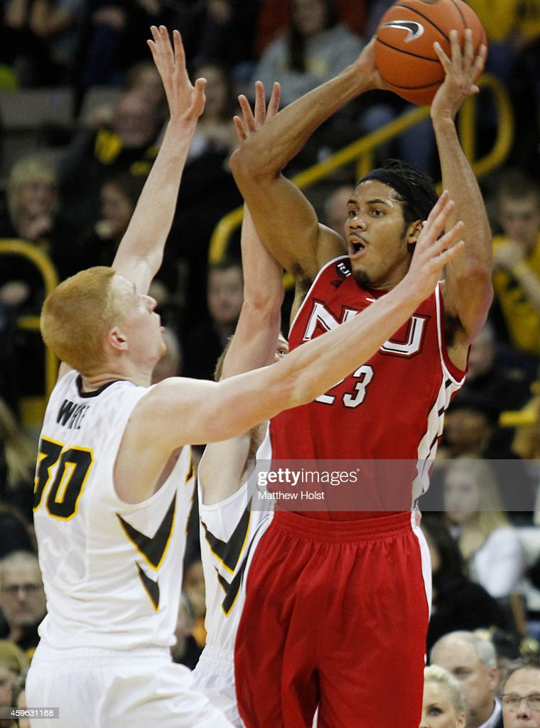 Guard Aaric Armstead #23 of the Northern Illinois Huskies passes the ball under pressure from forward <a gi-track='captionPersonalityLinkClicked' href=/galleries/search?phrase=Aaron+White+-+Basketball+Player&family=editorial&specificpeople=14619648 ng-click='$event.stopPropagation()'>Aaron White</a> #30 and guard Mike Gesell #10 of the Iowa Hawkeyes, in the first half on November 26, 2014 at Carver-Hawkeye Arena, in Iowa City, Iowa.