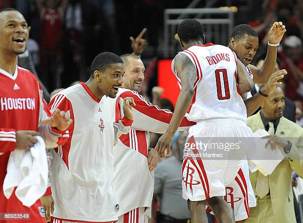 Guard Aaron Brooks of the Houston Rockets celebrates after making a threepoint shot against the Los Angeles Lakers in Game Four of the Western...