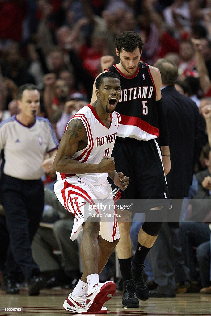 Guard Aaron Brooks of the Houston Rockets reacts after making a threepoint shot in front of Rudy Fernandez of the Portland Trail Blazers in Game Six...