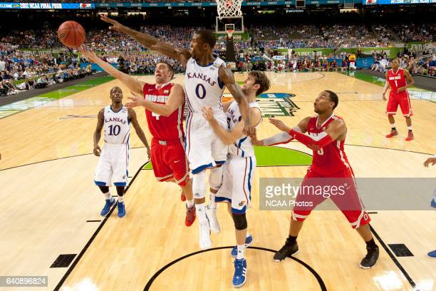 Guard Aaron Craft from Ohio State University can't control the ball in front of teammates forward Thomas Robinson and center Jeff Withey from the...