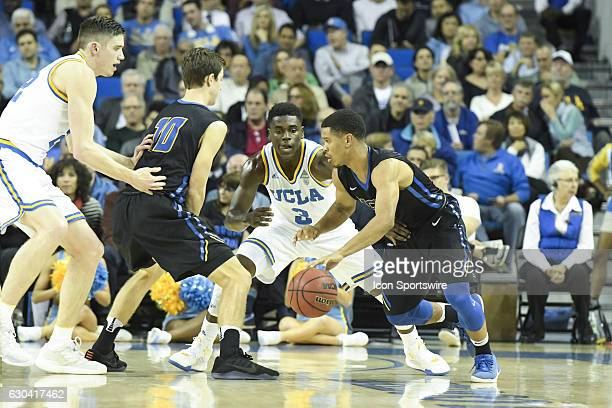 UCLA guard Aaron Holiday guards UCSB guard Eric Childress during an NCAA basketball game between the UC Santa Barbara Gauchos and the UCLA Bruins on...