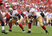 Guard Adam Snyder and tackle Joe Staley of the San Francisco 49ers set to block against the Tampa Bay Buccaneers December 15 2013 at Raymond James...