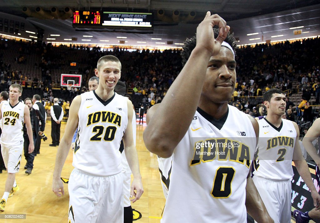 Guard Ahmad Wagner and forward Jarrod Uthoff of the Iowa Hawkeyes walk off the court after their matchup against the Northwestern Wildcats on January...