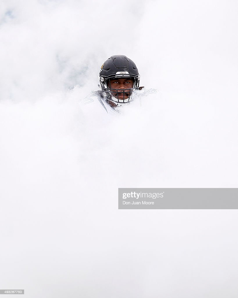 Guard AJ Cann of the Jacksonville Jaguars emerges from a cloud of smoke during the team's intro before the game against the Houston Texans at...