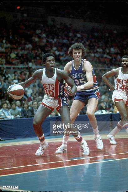 Guard Al Skinner of the New York Nets in action against forward Dave Robisch of the Denver Nuggets as guard Brian Taylor watches during an American...