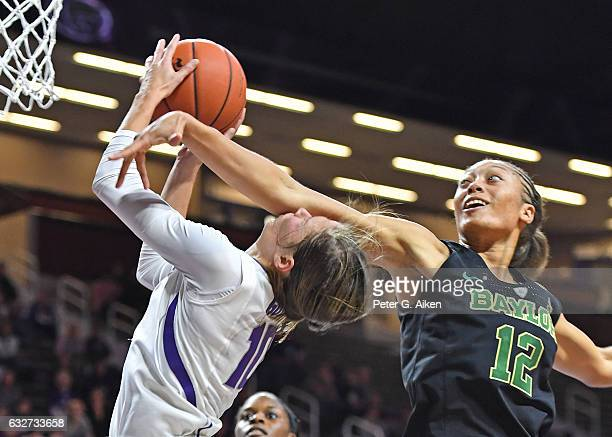 Guard Alexis Prince of the Baylor Bears fouls guard Kayla Goth of the Kansas State Wildcats driving to the basket during the second half on January...