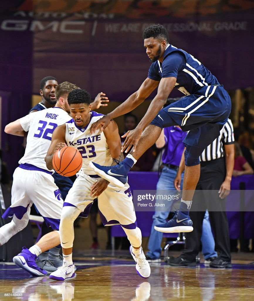 Guard Amaad Wainright #23 of the Kansas State Wildcats steals the ball away from forward Emmanuel Nzekwesi (R) of the Oral Roberts Golden Eagles during the second half on November 29, 2017 at Bramlage Coliseum in Manhattan, Kansas.