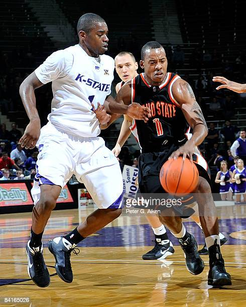 Guard Amorrow Morgan of the Idaho State Bengals drives against pressure from guard Fred Brown of the Kansas State Wildcats during the first half on...