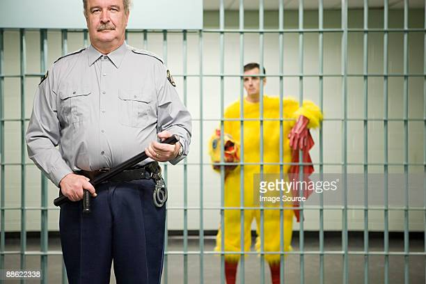 Guard and prisoner in chicken suit