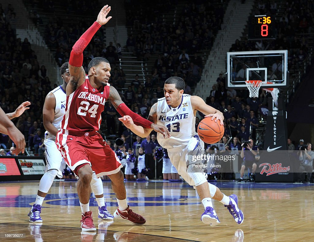 Guard Angel Rodriguez #13 of the Kansas State Wildcats brings the ball up court against forward Romero Osby #24 of the Oklahoma Sooners during the second half on January 19, 2013 at Bramlage Coliseum in Manhattan, Kansas. Kansas State defeated Oklahoma 69-60.