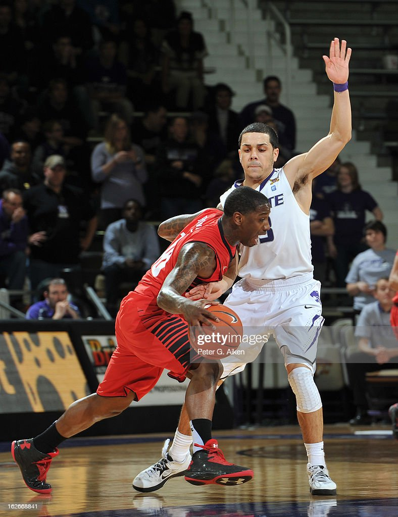 Guard Angel Rodriguez #13 of the Kansas State Wildcats defends against guard Daylen Robinson #10 of the Texas Tech Red Raiders during the second half on February 25, 2013 at Bramlage Coliseum in Manhattan, Kansas. Kansas State defeated Texas Tech 75-55.