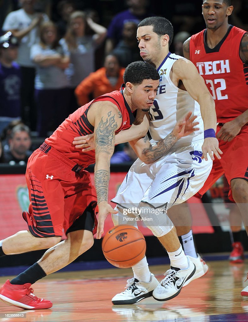 Guard Angel Rodriguez #13 of the Kansas State Wildcats defends against guard Josh Gray #5 of the Texas Tech Red Raiders during the second half on February 25, 2013 at Bramlage Coliseum in Manhattan, Kansas. Kansas State defeated Texas Tech 75-55.
