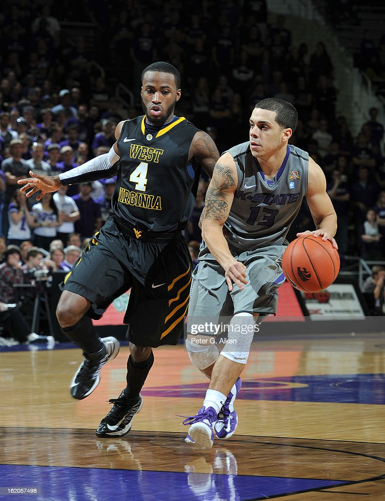 Guard Angel Rodriguez #13 of the Kansas State Wildcats drives against guard Jabarie Hinds #4 of the West Virginia Mountaineers during the second half on February 18, 2013 at Bramlage Coliseum in Manhattan, Kansas. Kansas State defeated West Virginia 71-61.