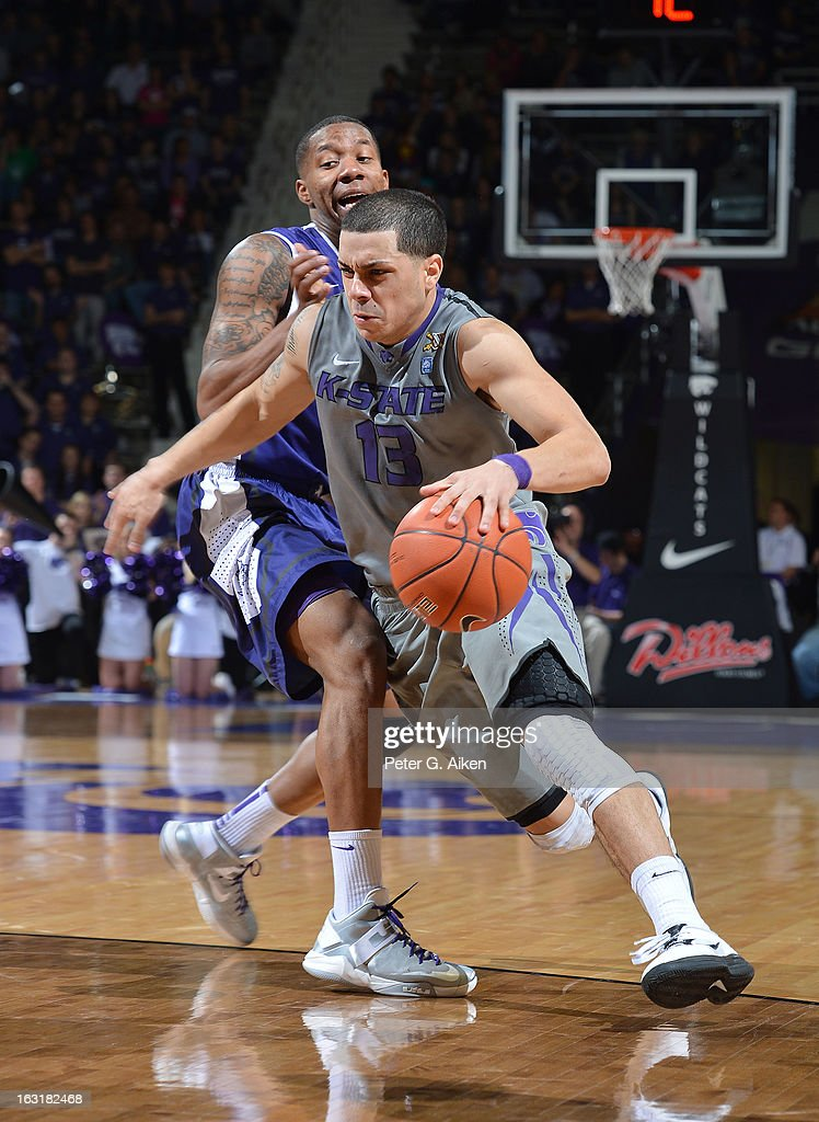Guard Angel Rodriguez #13 of the Kansas State Wildcats drives against guard Charles Hill #0 of the Texas Christian Horned Frogs during the second half on March 5, 2013 at Bramlage Coliseum in Manhattan, Kansas. Kansas State defeated Texas Christian 79-68.