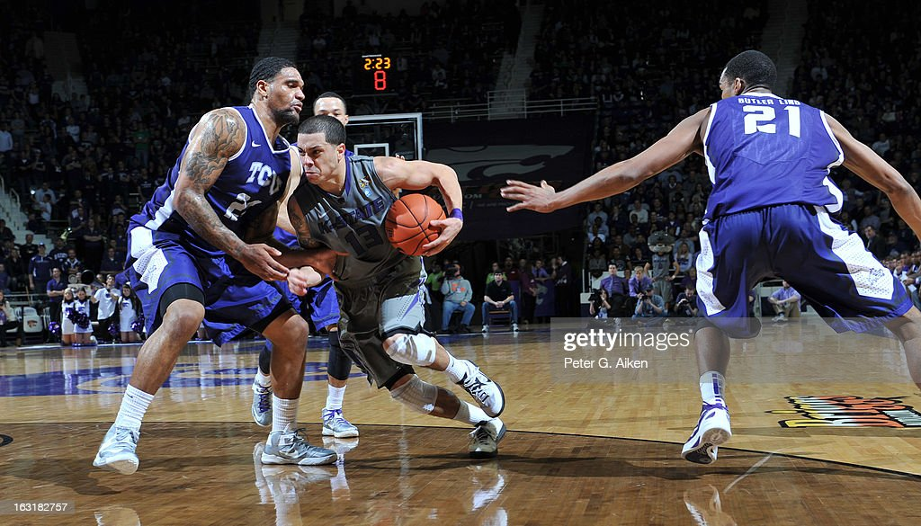 Guard Angel Rodriguez #13 of the Kansas State Wildcats drives between defenders Adrick McKinney #24 and Nate Butler Lind #21 of the Texas Christian Horned Frogs during the second half on March 5, 2013 at Bramlage Coliseum in Manhattan, Kansas. Kansas State defeated Texas Christian 79-68.
