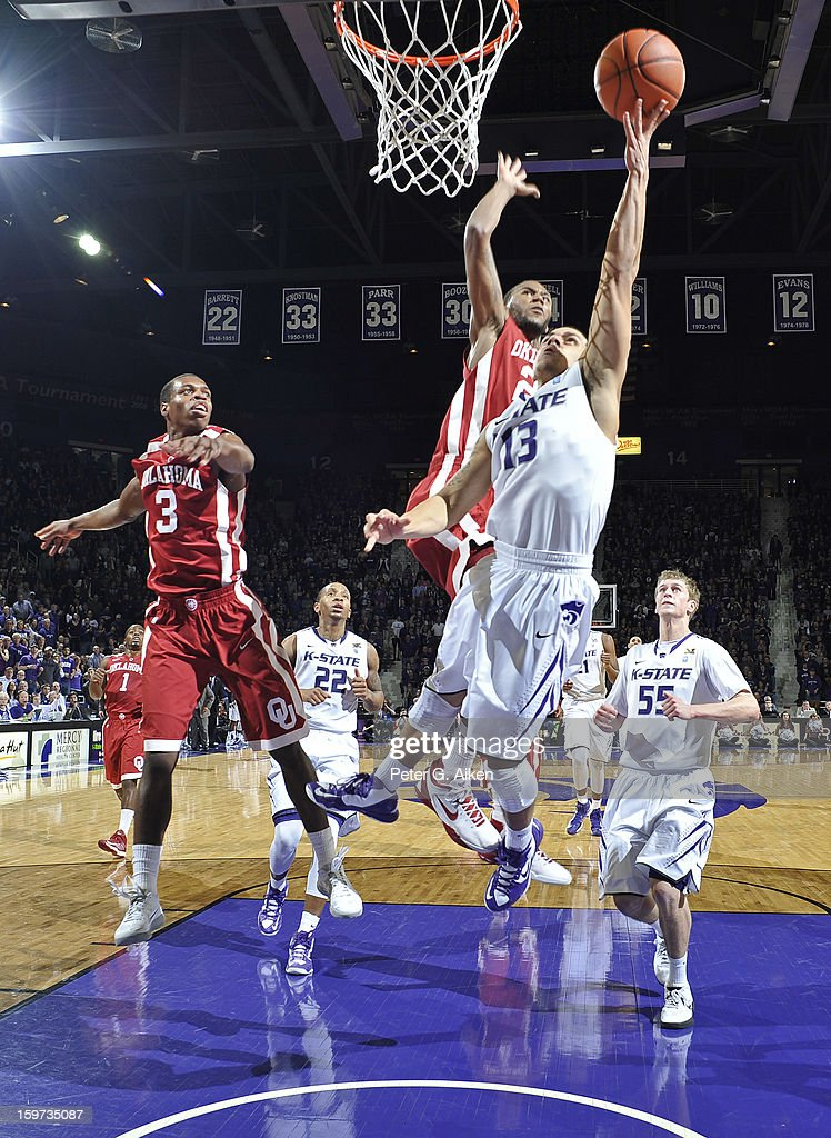 Guard Angel Rodriguez #13 of the Kansas State Wildcats drives in for a basket past guard Steven Pledger #2 of the Oklahoma Sooners during the first half on January 19, 2013 at Bramlage Coliseum in Manhattan, Kansas. Kansas State defeated Oklahoma 69-60.