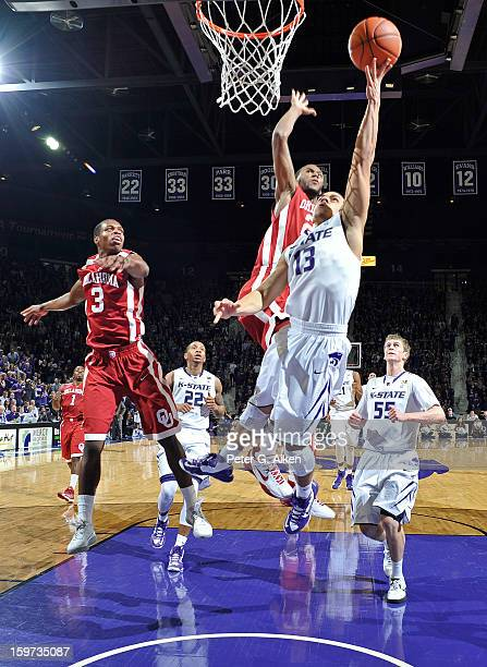 Guard Angel Rodriguez of the Kansas State Wildcats drives in for a basket past guard Steven Pledger of the Oklahoma Sooners during the first half on...