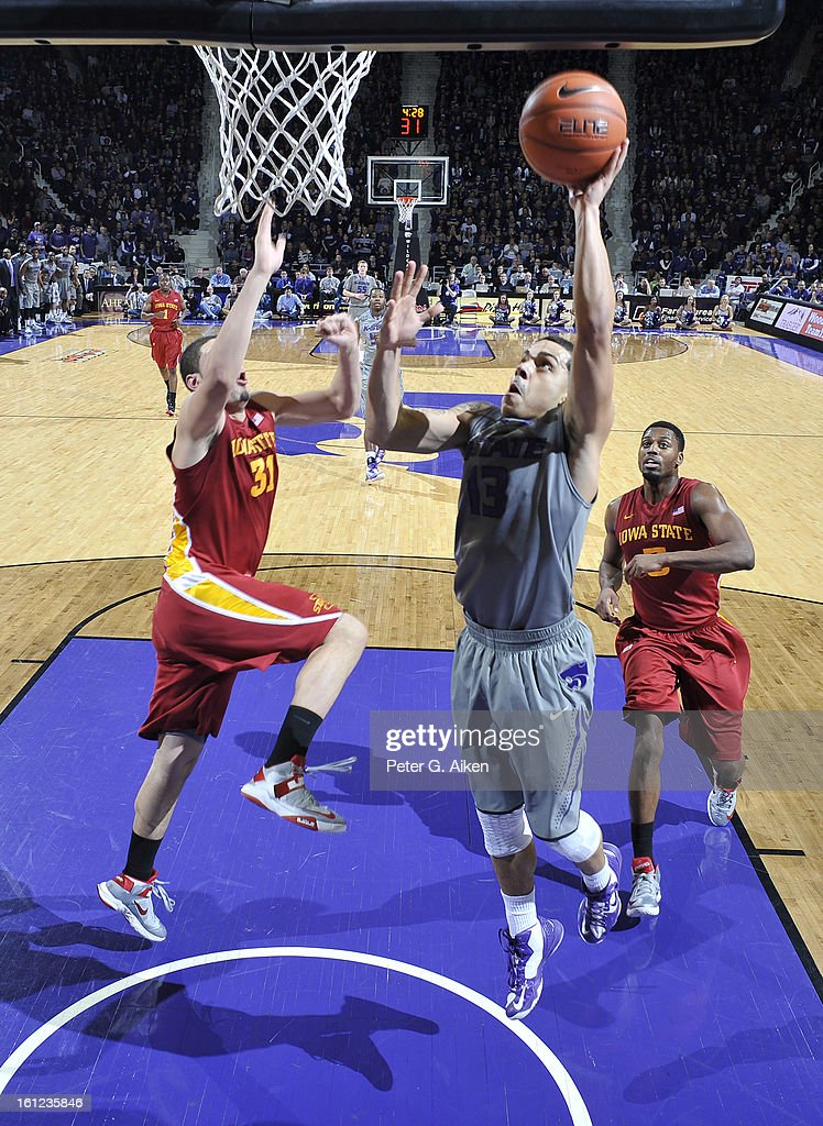 Guard Angel Rodriguez #13 of the Kansas State Wildcats drives in for a basket past defender Georges Niang #31 of the Iowa State Cyclones during the first half on February 9, 2013 at Bramlage Coliseum in Manhattan, Kansas. Kansas State defeated Iowa State 79-70.