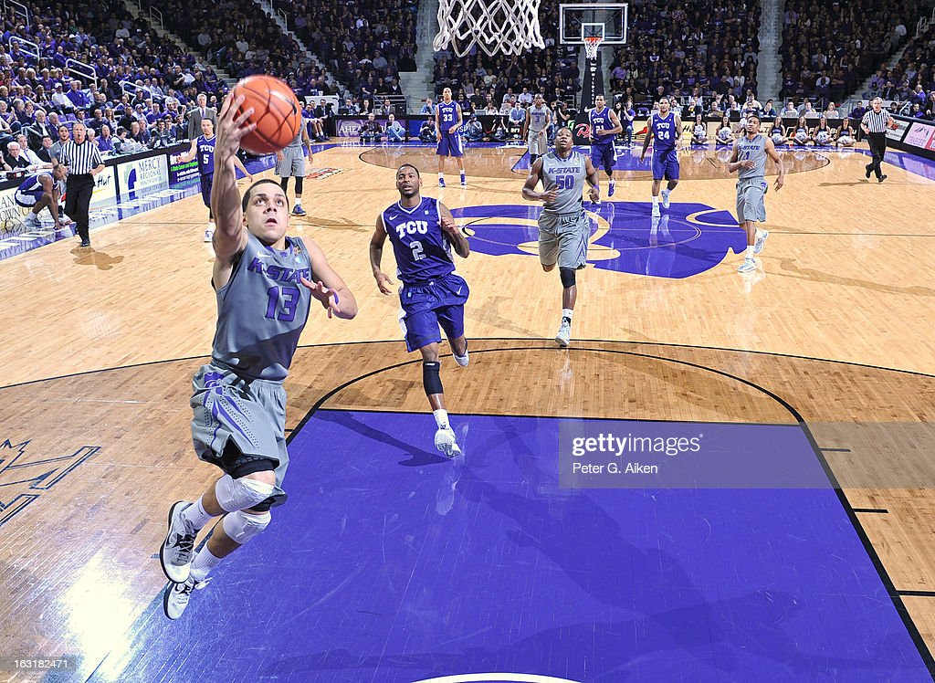 Guard Angel Rodriguez #13 of the Kansas State Wildcats drives in for a basket against the Texas Christian Horned Frogs during the first half on March 5, 2013 at Bramlage Coliseum in Manhattan, Kansas. Kansas State defeated Texas Christian 79-68.