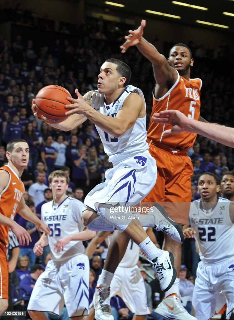 Guard Angel Rodriguez #13 of the Kansas State Wildcats drives to the basket past forward Jaylen Bond #5 of the Texas Longhorns during the second half on January 30, 2013 at Bramlage Coliseum in Manhattan, Kansas. Kansas State defeated Texas 83-57.