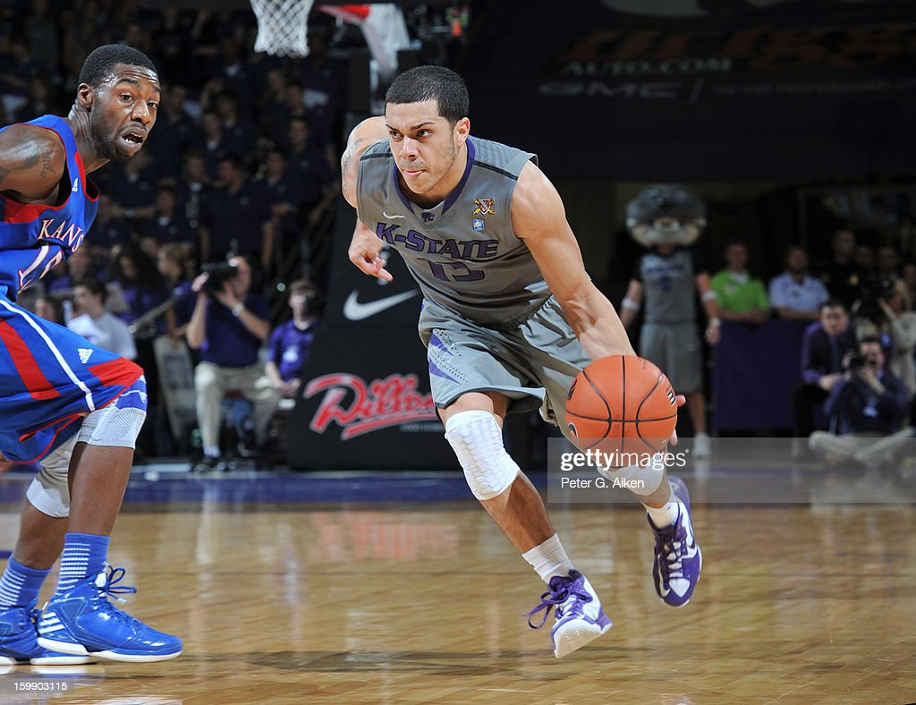 Guard Angel Rodriguez #13 of the Kansas State Wildcats drives up court against the Kansas Jayhawks during the second half on January 22, 2013 at Bramlage Coliseum in Manhattan, Kansas. Kansas defeated Kansas State 59-55.