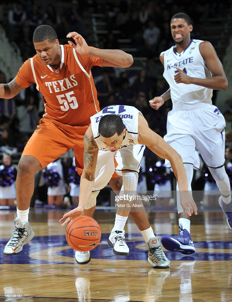 Guard Angel Rodriguez #13 of the Kansas State Wildcats gets hit from behind by center Cameron Ridley #55 of the Texas Longhorns during the second half on January 30, 2013 at Bramlage Coliseum in Manhattan, Kansas. Kansas State defeated Texas 83-57.