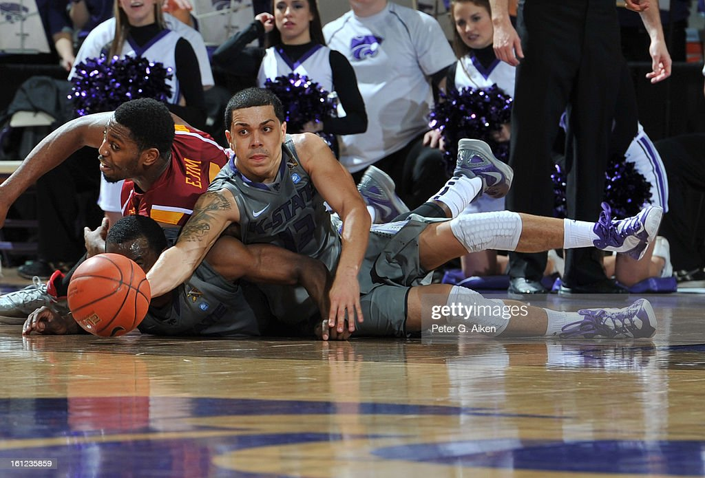 Guard Angel Rodriguez #13 of the Kansas State Wildcats reaches for a loose ball on the floor against forward Melvin Ejim #3 of the Iowa State Cyclones during the second half on February 9, 2013 at Bramlage Coliseum in Manhattan, Kansas. Kansas State defeated Iowa State 79-70.